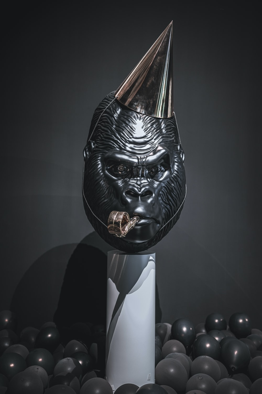 shallow focus photo of black gorilla mask
