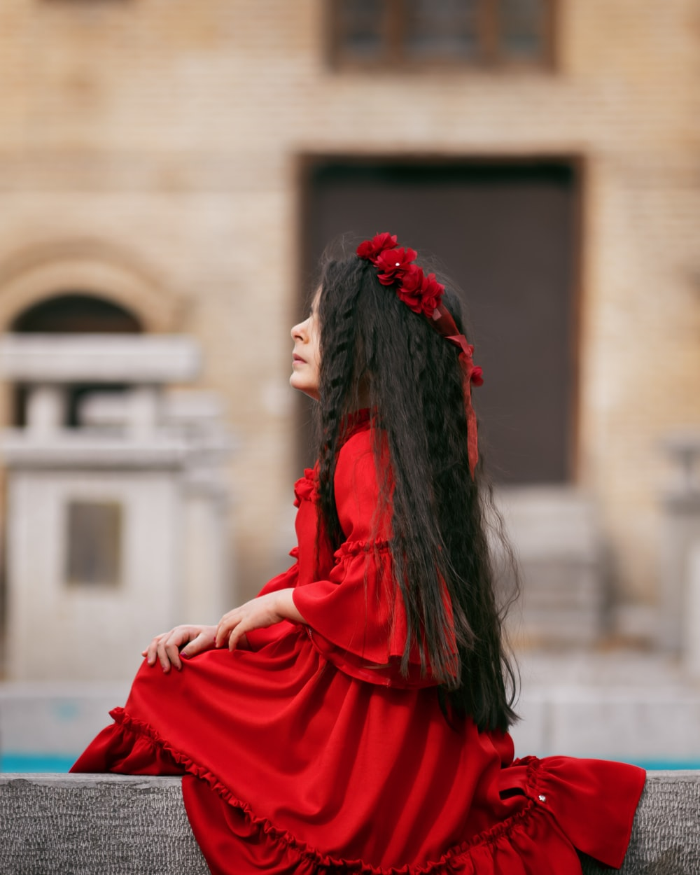 girl sitting on concrete railing