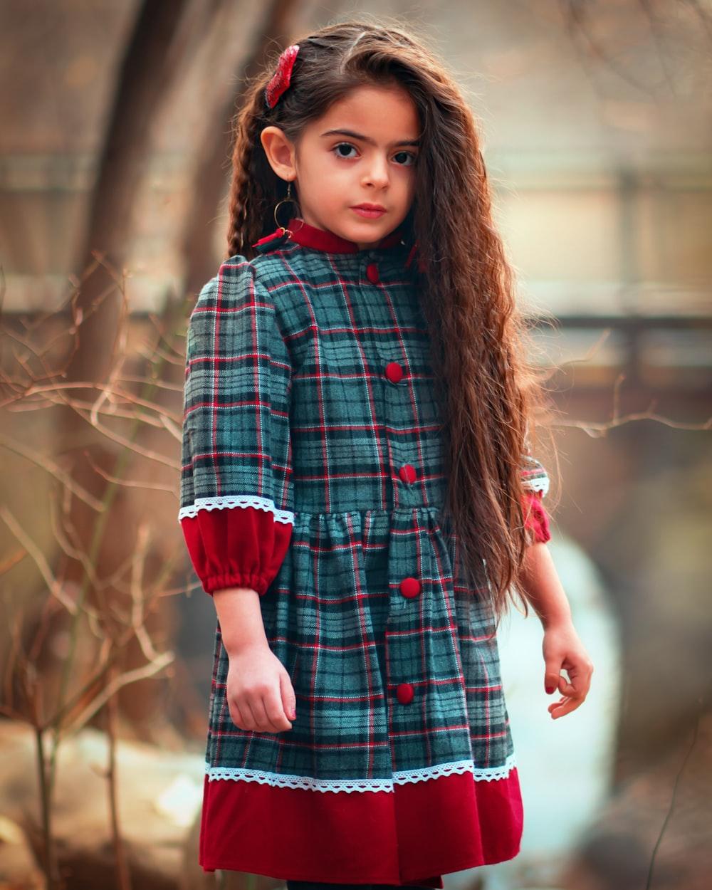 girl standing near tree