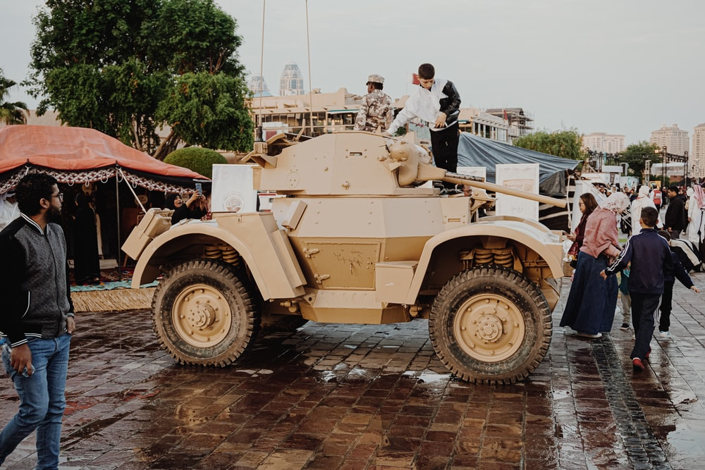 man riding brown battle tank