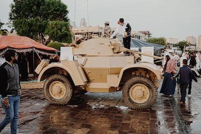 man riding brown battle tank qatar zoom background