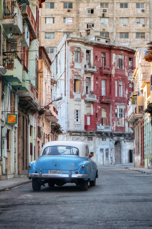blue vehicle running on empty street