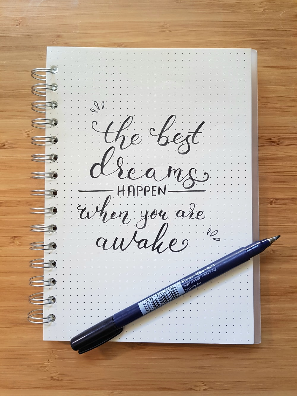 the best dreams happen when you are awake notebook and black pen