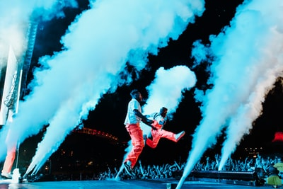 two person performing on stage pyro zoom background