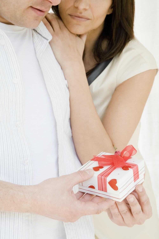 couple holding gift box