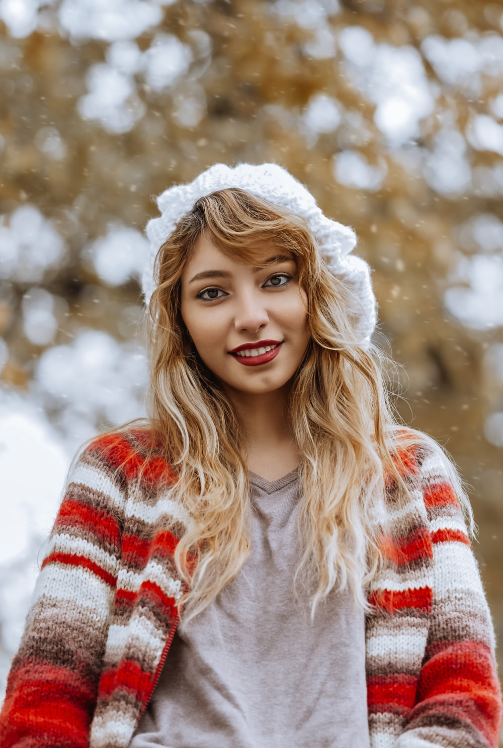 woman in red and white sweater