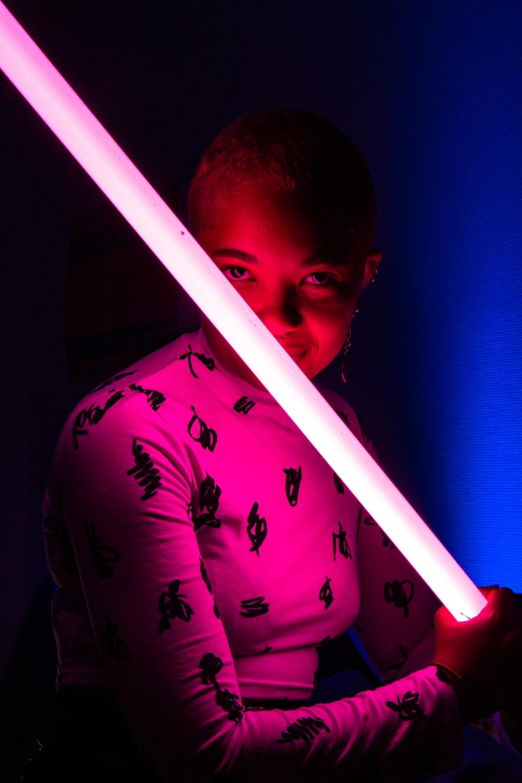 woman holding lightsaber