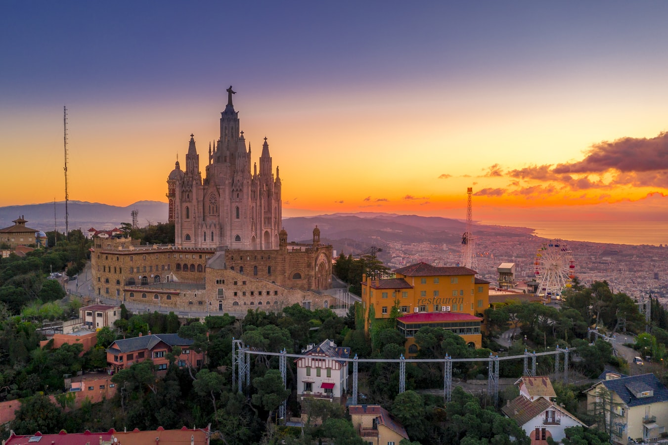 A cathedral on top of a hill overlooking Barcelona, Spain