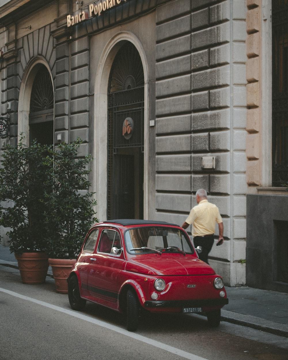 red 3-door hatchback parked on the street