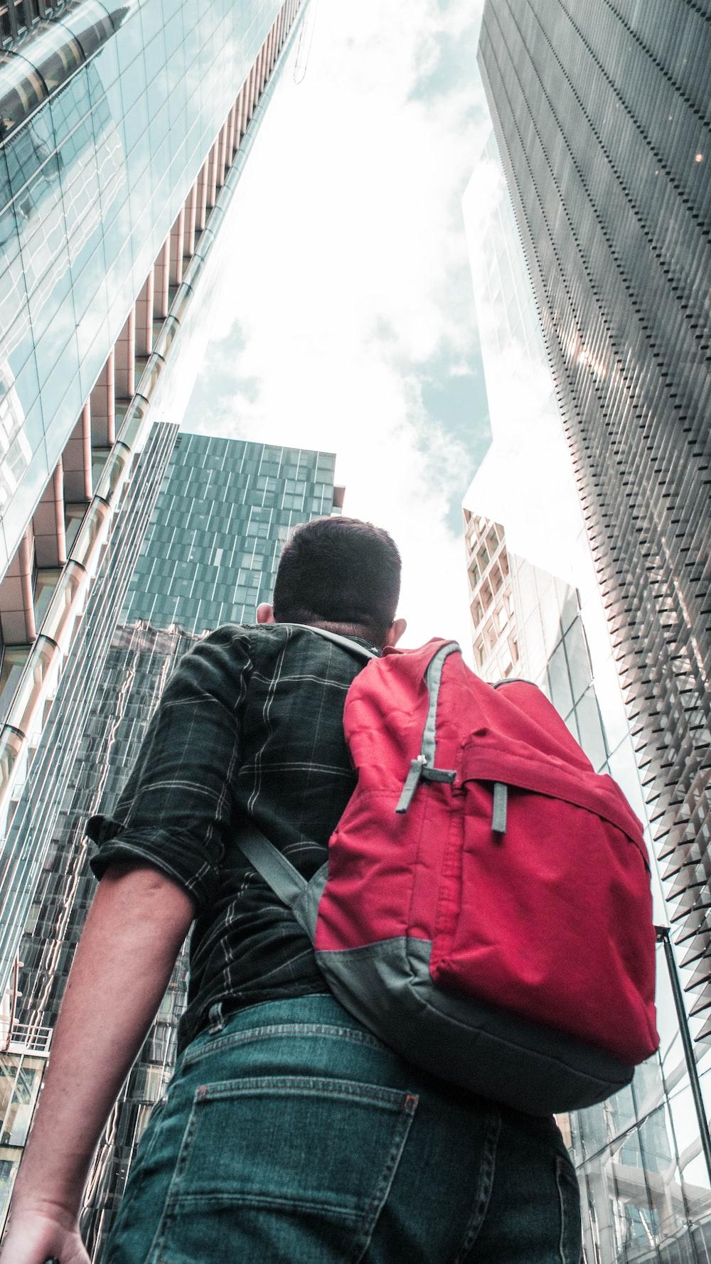 man standing between high-rise buildings