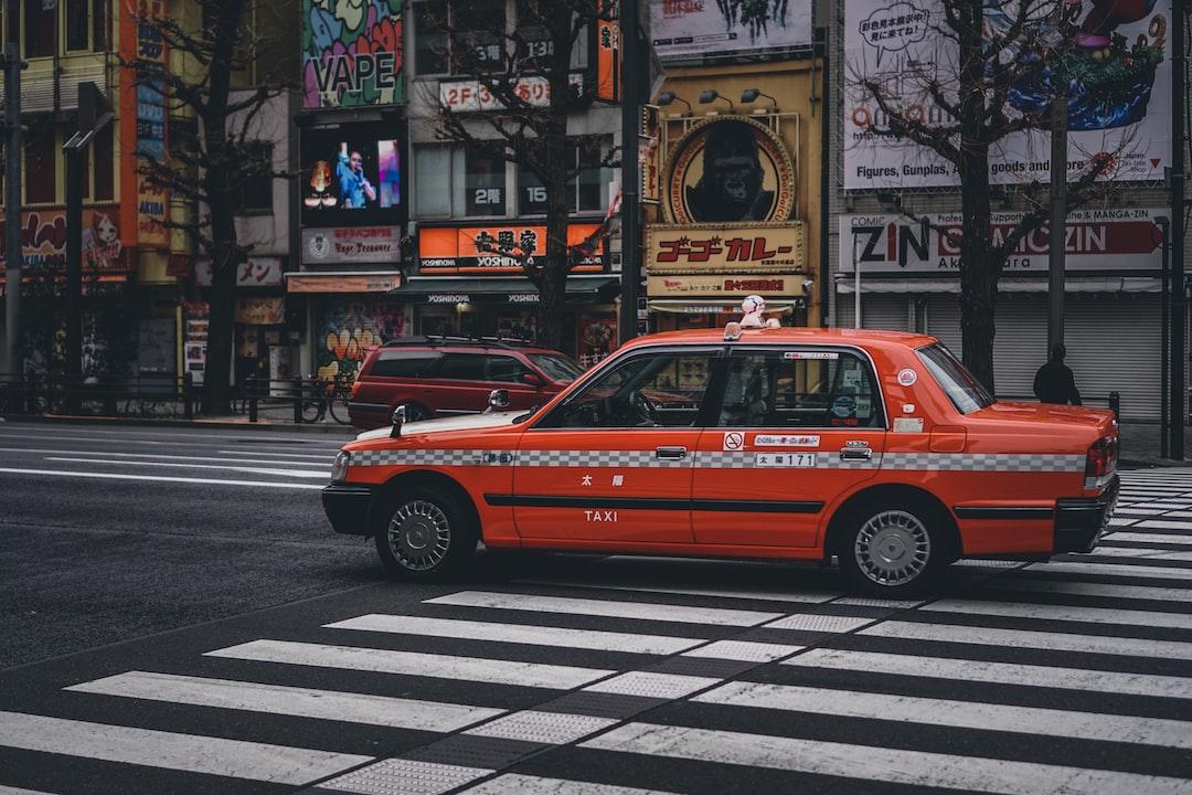 Red Taxi On Pedestrian Lane - unsplash