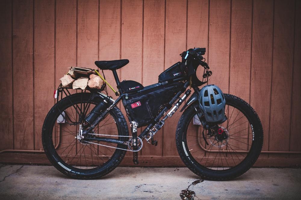 black bike beside wall