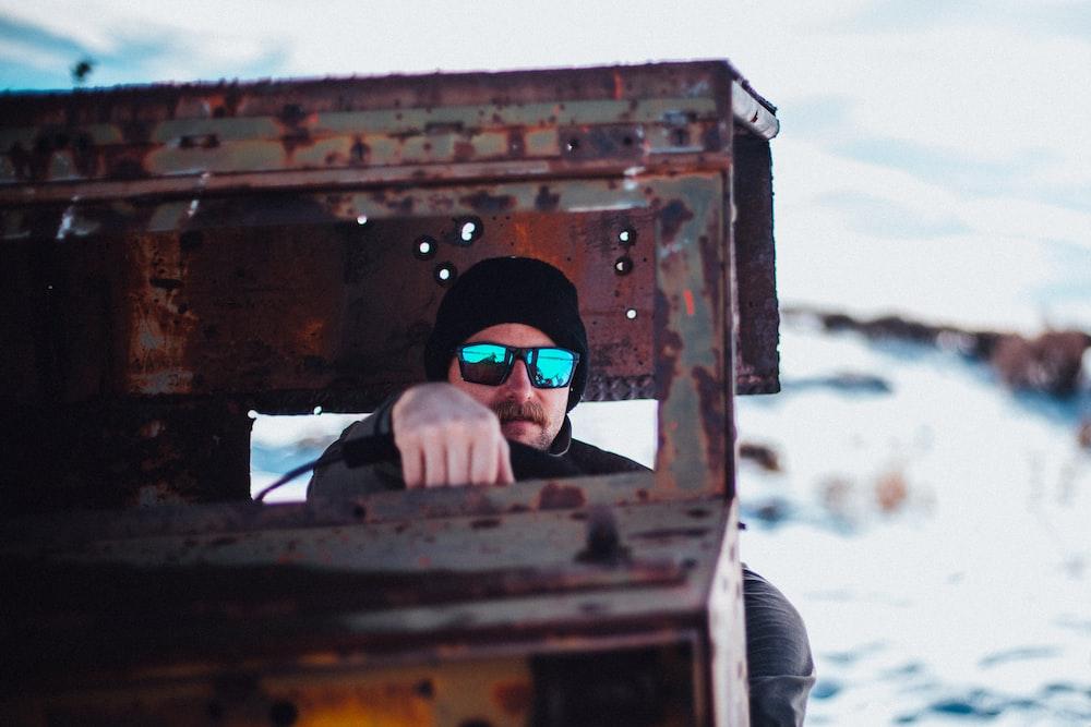 selective focus photo of man riding vehicle