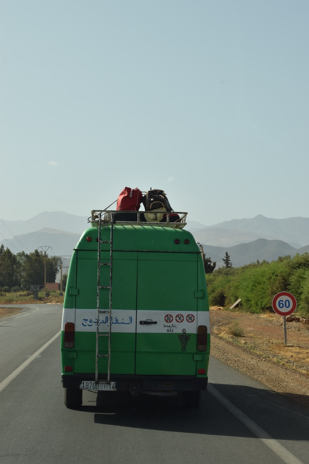 green and white van on road