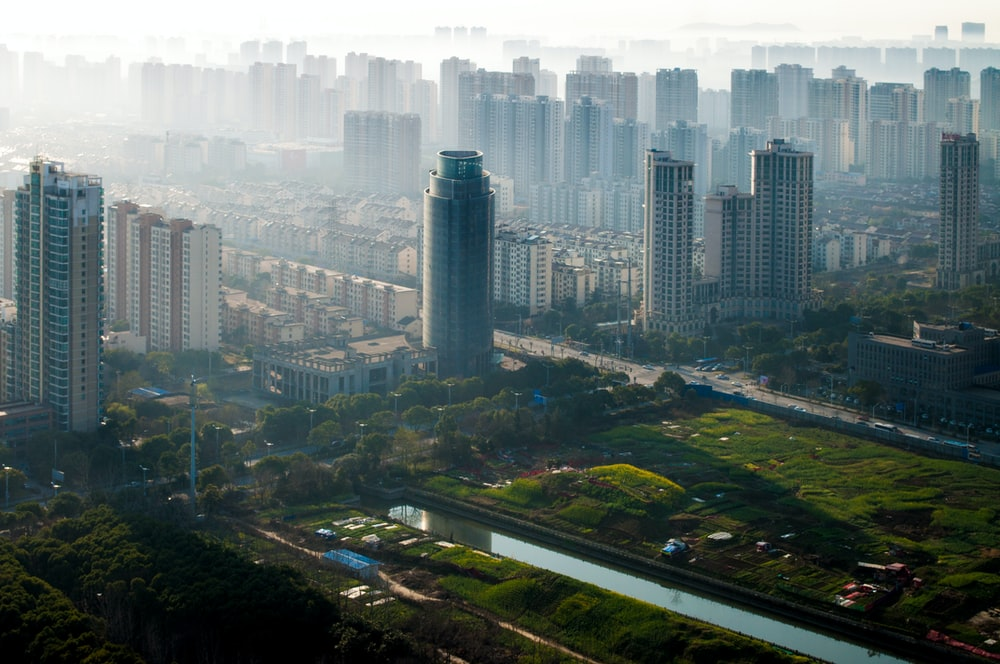 high-angle photography of city buildings and green trees