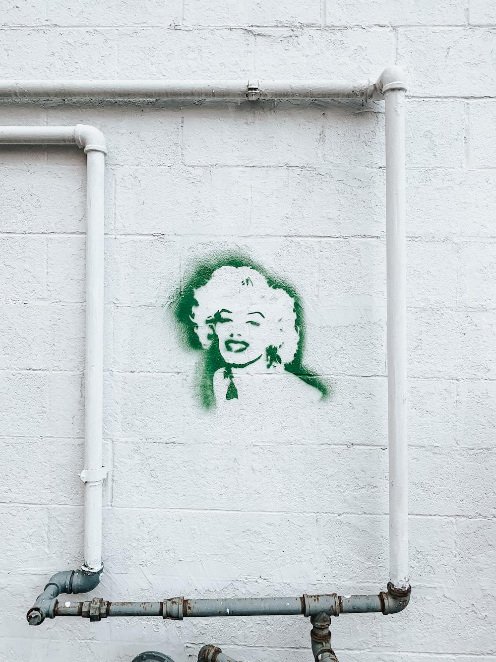 Marilyn Monroe graffiti on white wall