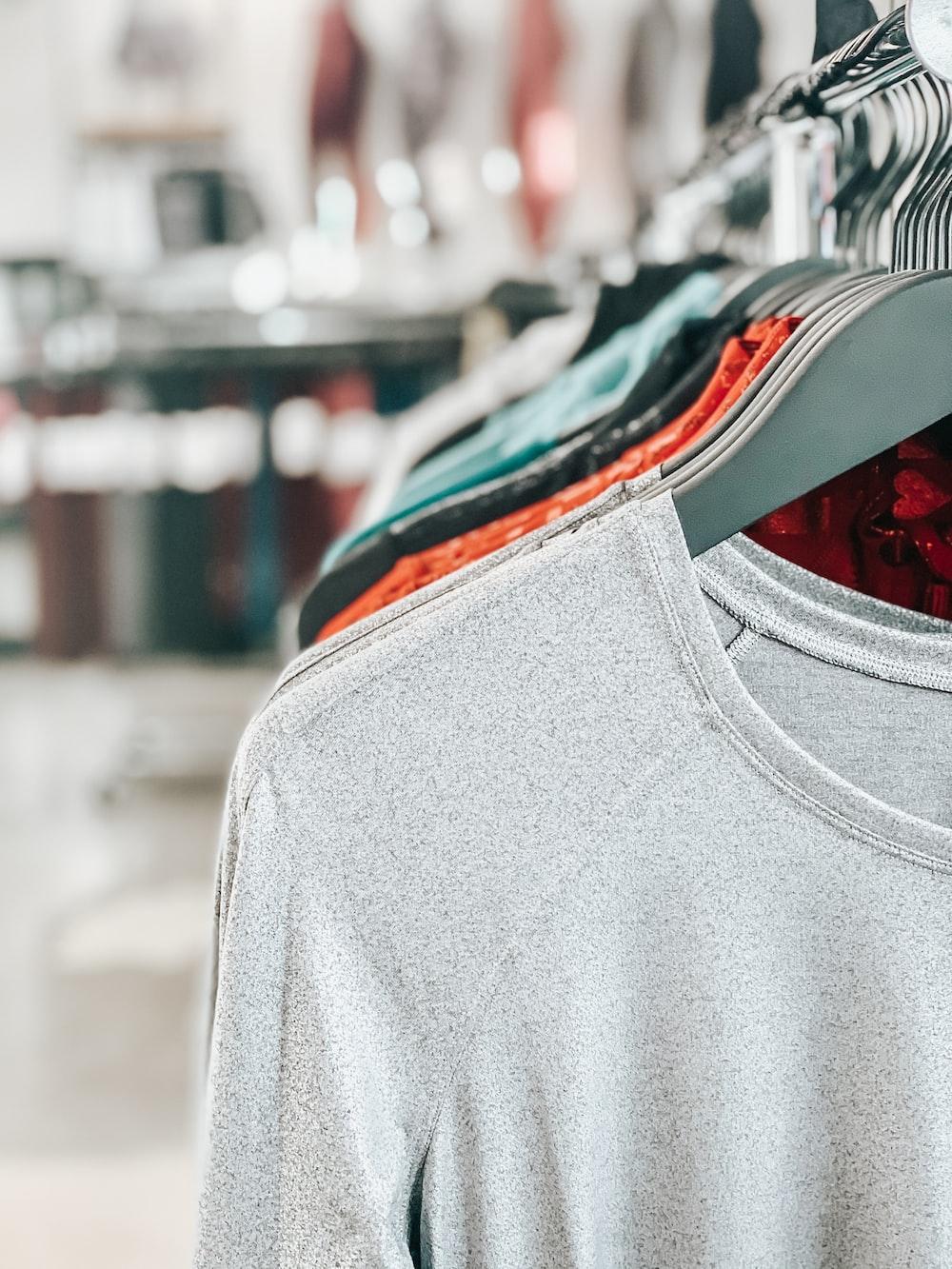 white crew-neck shirt on hanger