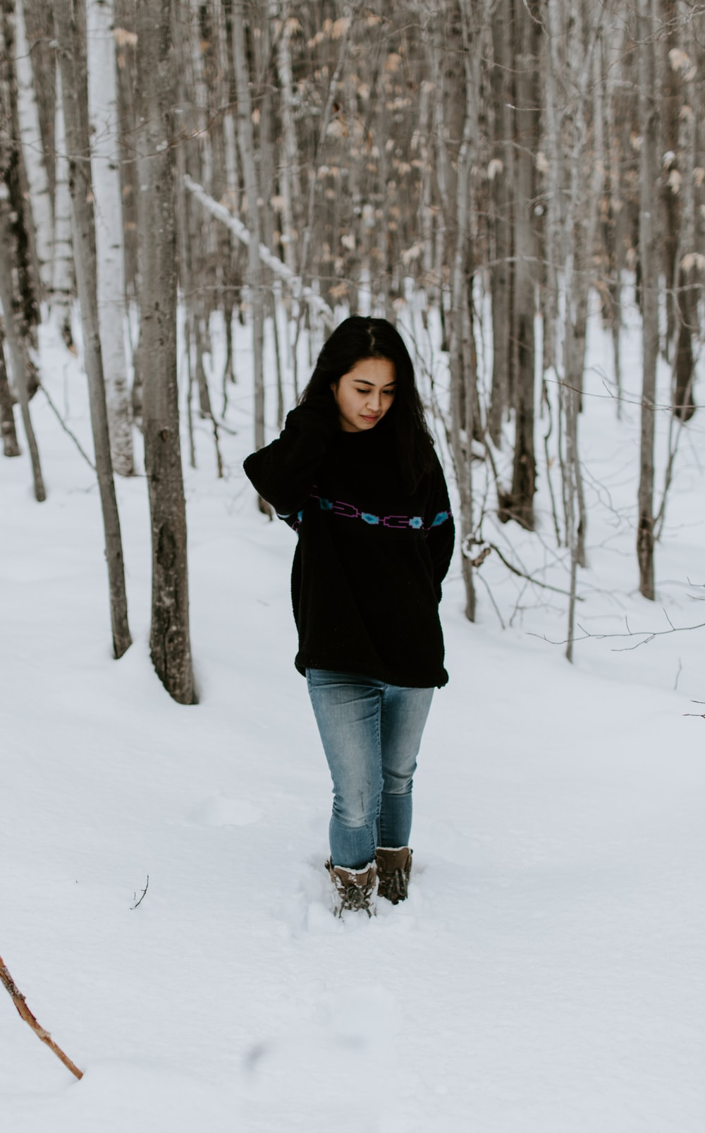 woman in black shirt standing on snow