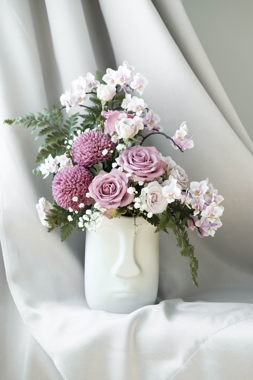 vase of pink-and-white-petaled flower