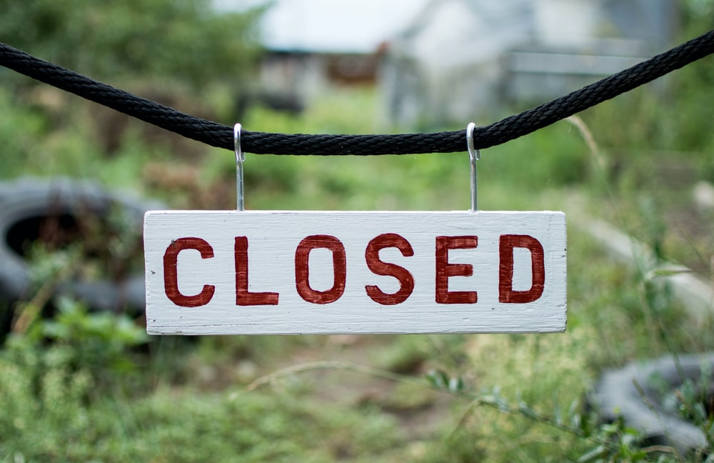 closed sign on string