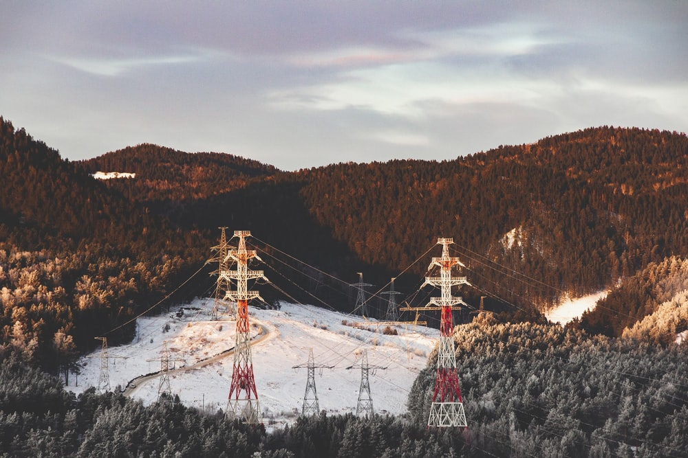 electric towers on mountain ranges