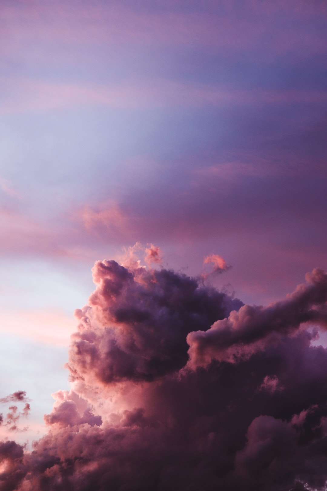 Sunset sky with cotton clouds, a full of pink and magenta cluods
