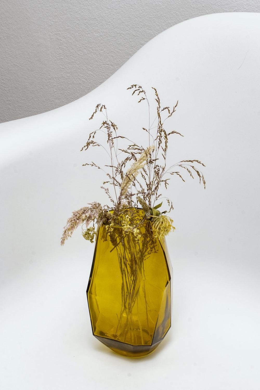 grasses in yellow translucent glass vase