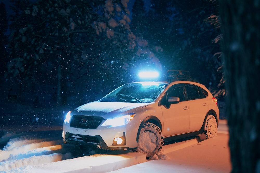 white vehicle on snow