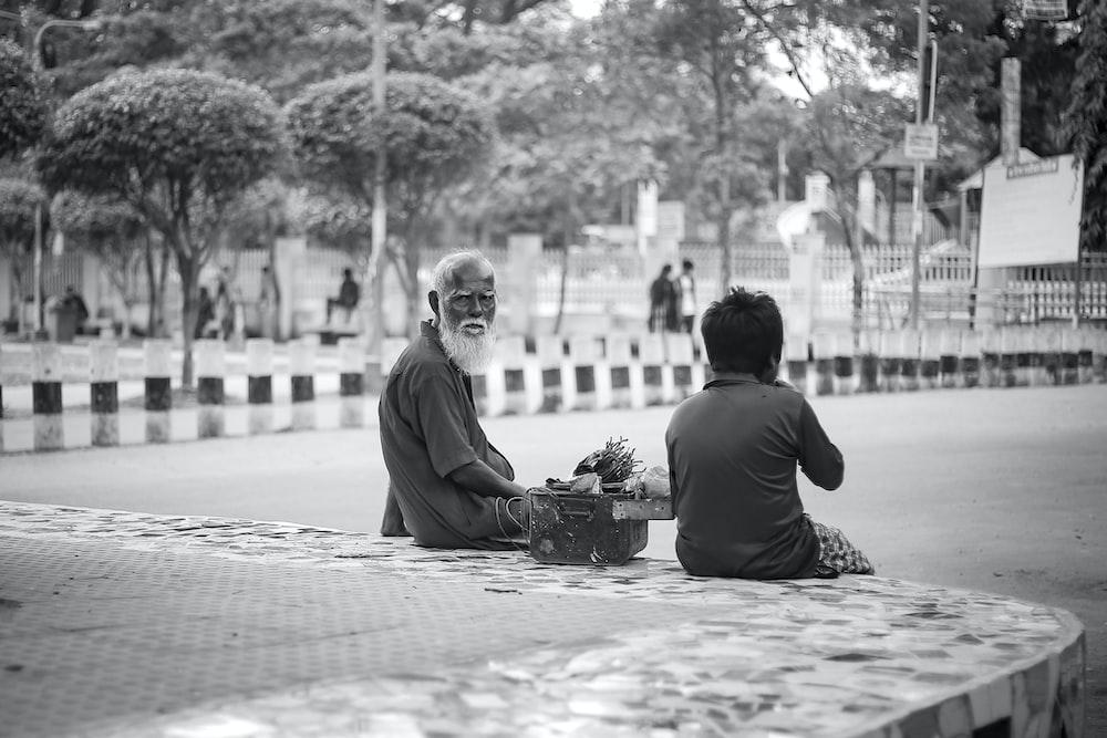 man sitting beside the boy