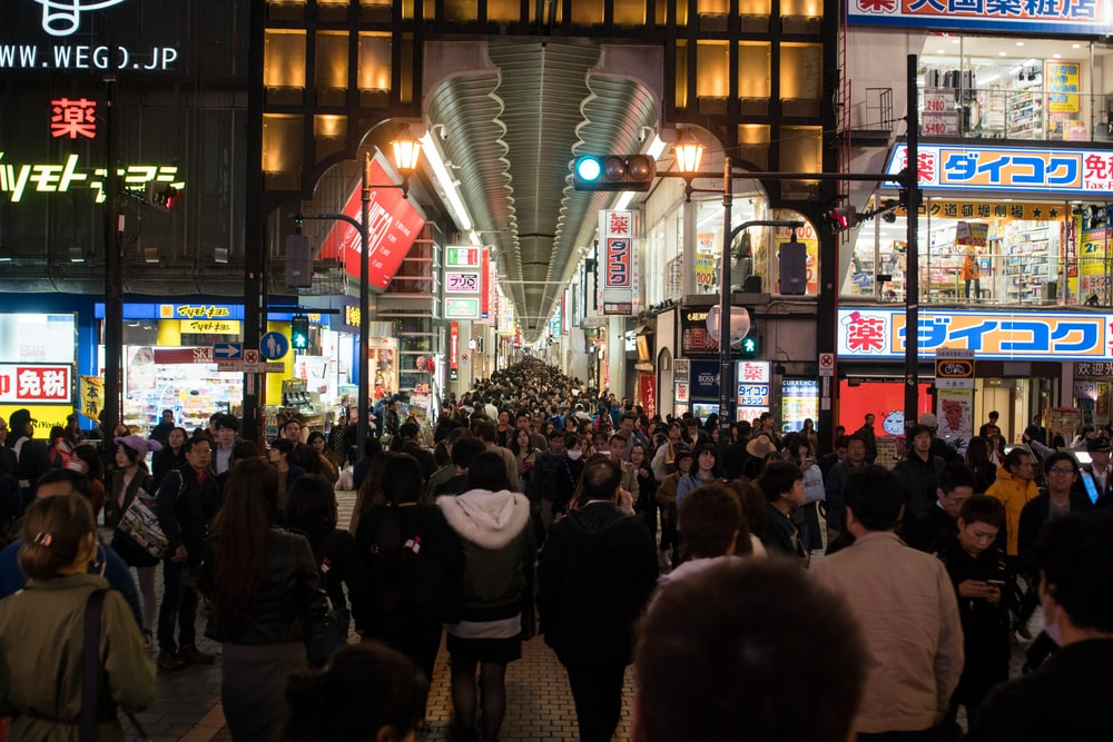 people in street during night time