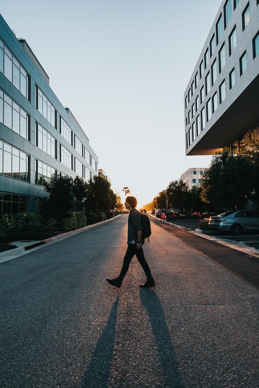 man walking on the road