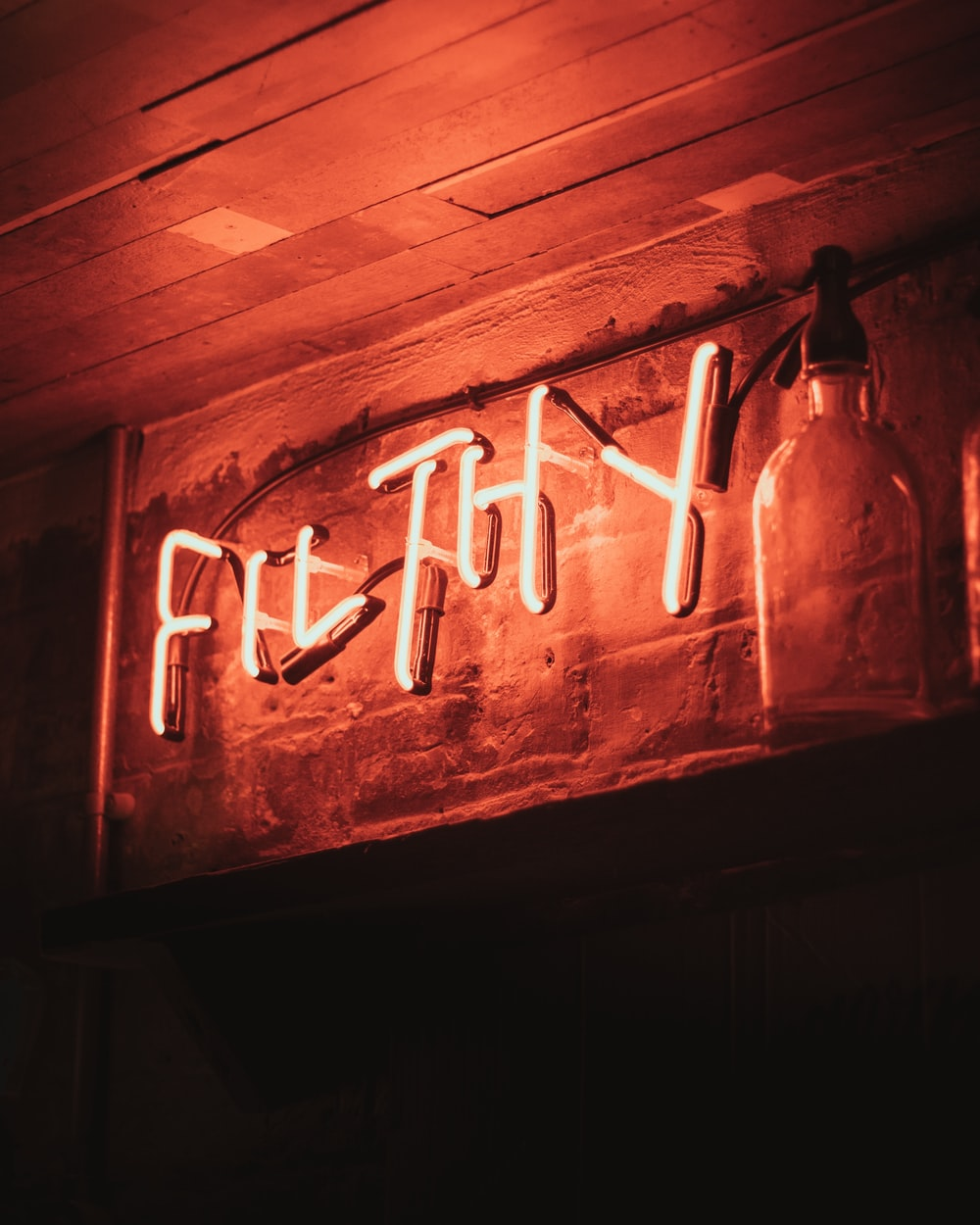 Filthy neon light signage