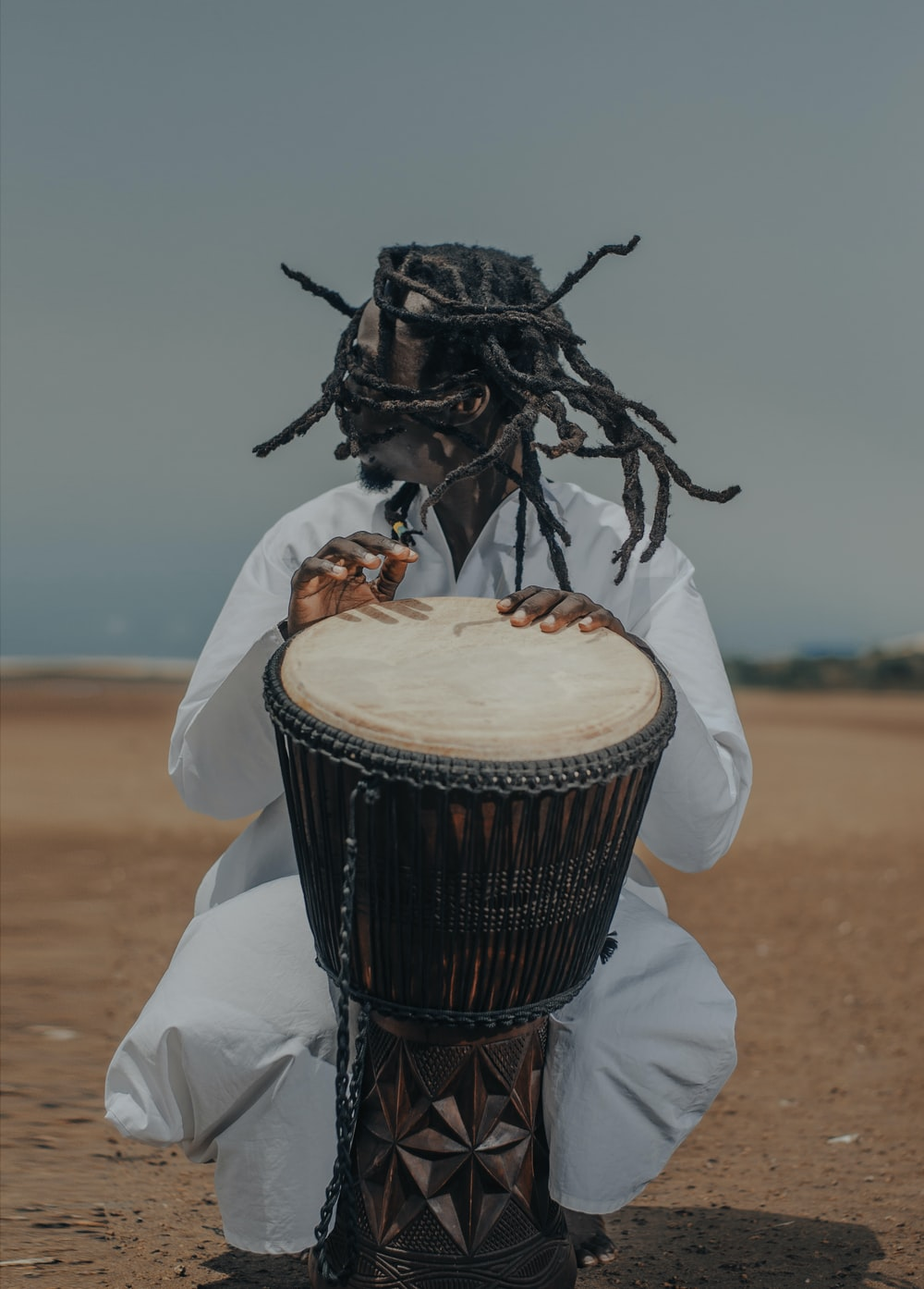 man playing percussion drum