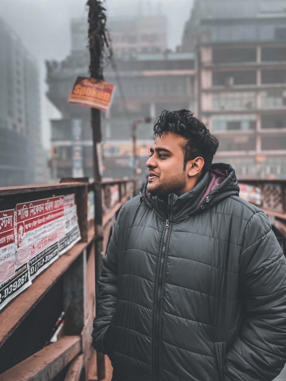 man wearing black bubble zip-up jacket