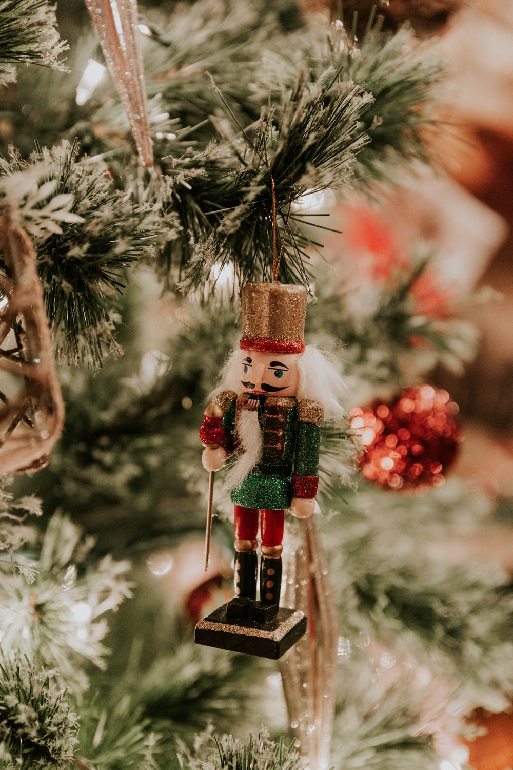 red, brown, and green nutcracker Christmas tree decor