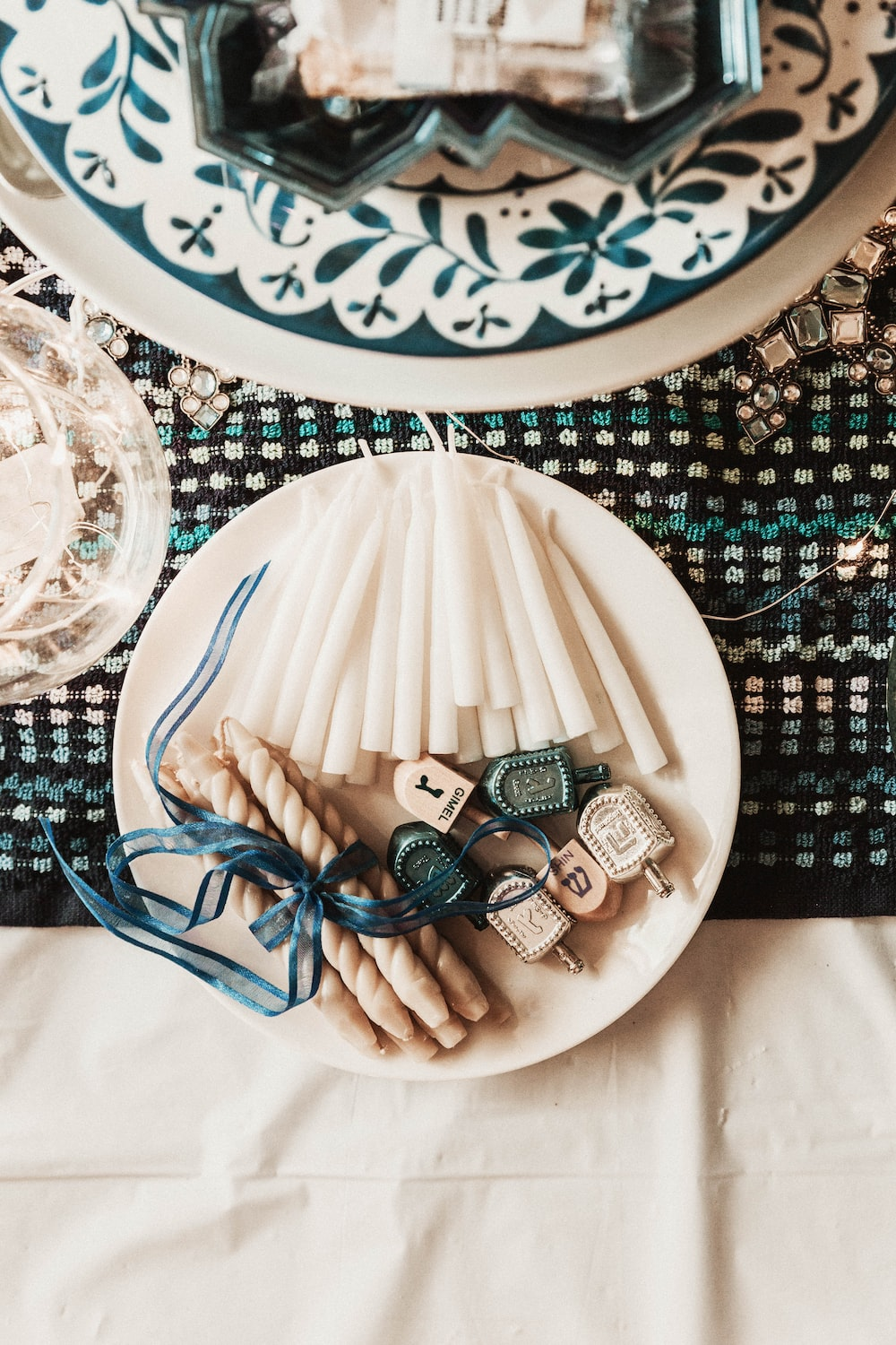 white candles on plate
