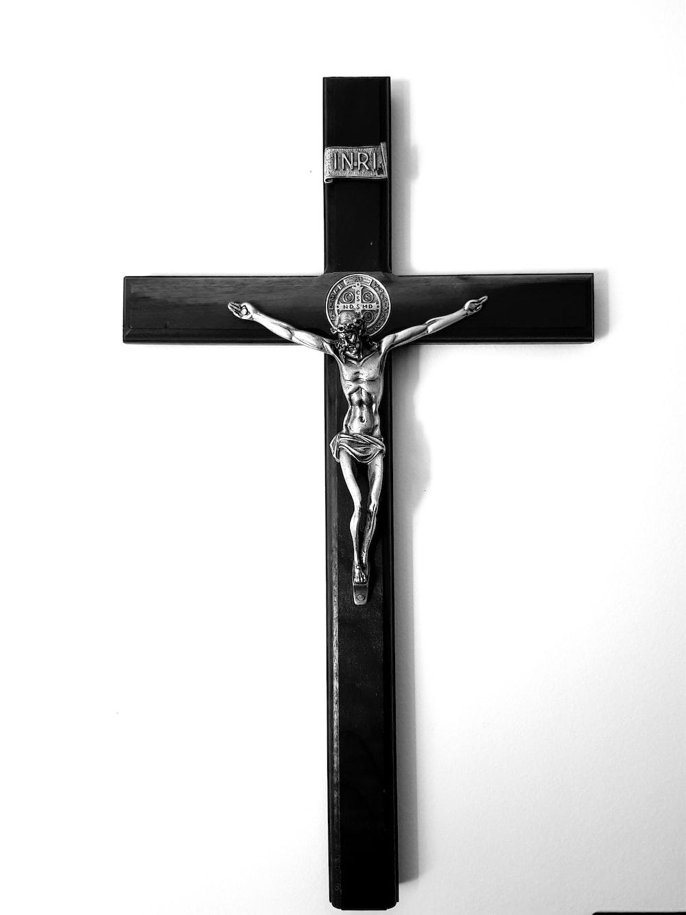 black and silver-colored crucifix