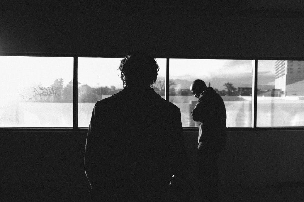 silhouette of man near the glass window