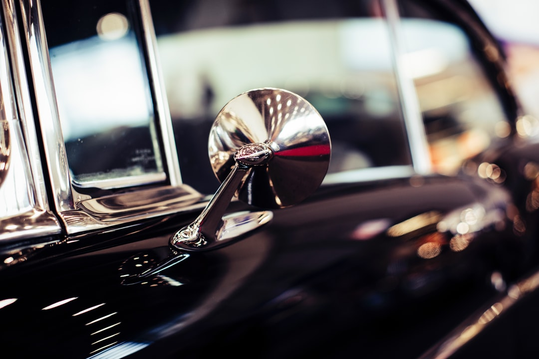 Classiv Vintage Oldtimer Car With Chromed Rear Mirror - unsplash