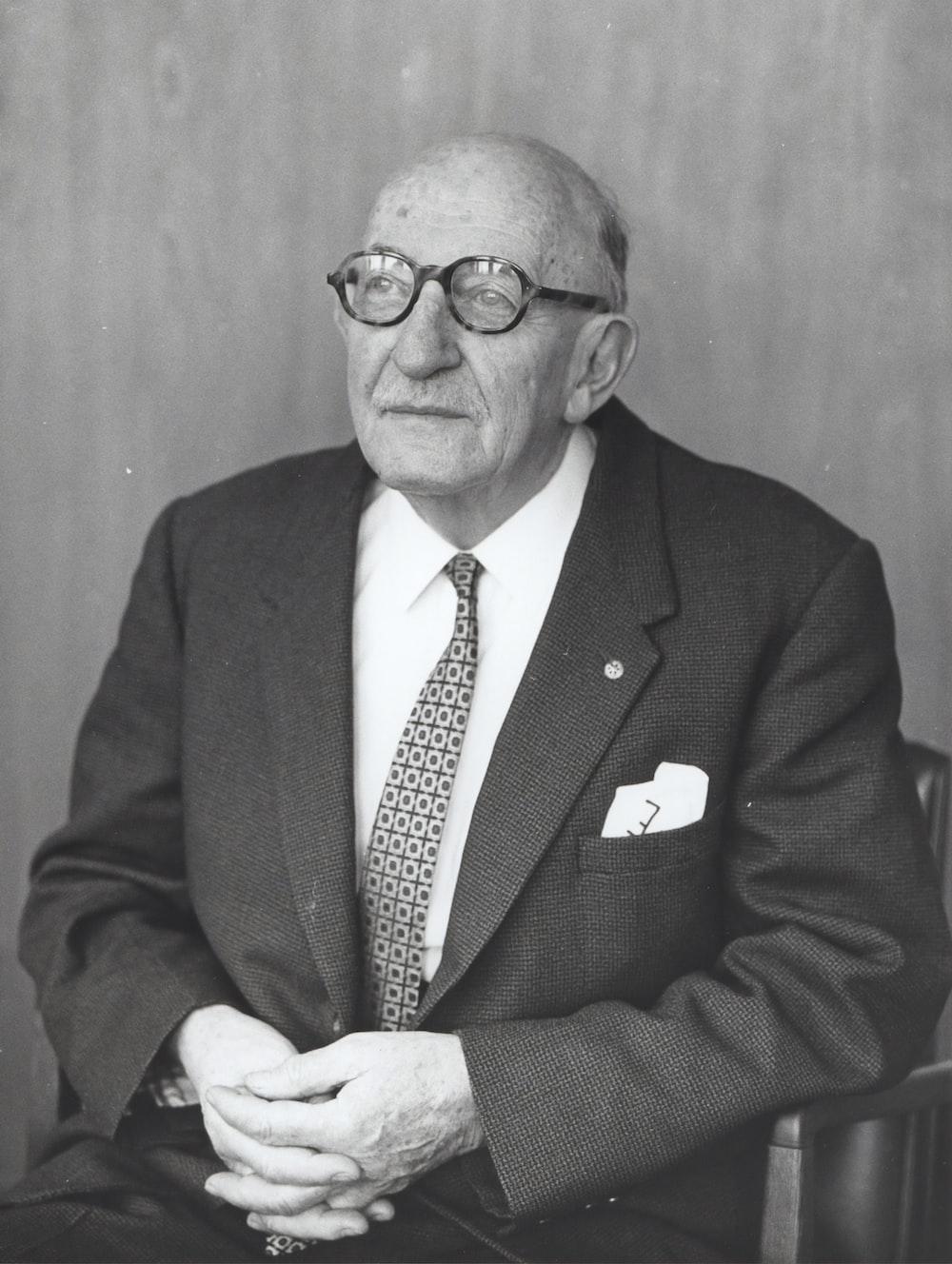 man wearing suit jacket and eyeglasses