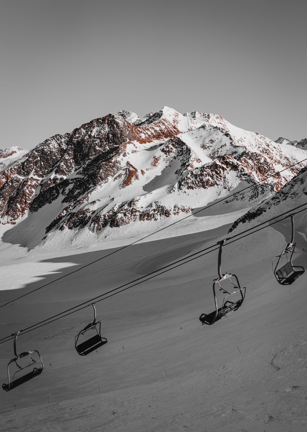 cable car above snow field