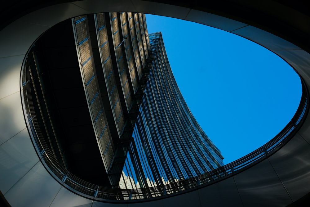 architectural photography of gray and blue concrete building