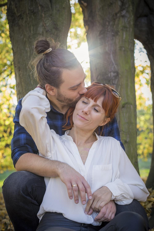 couple sitting under tree