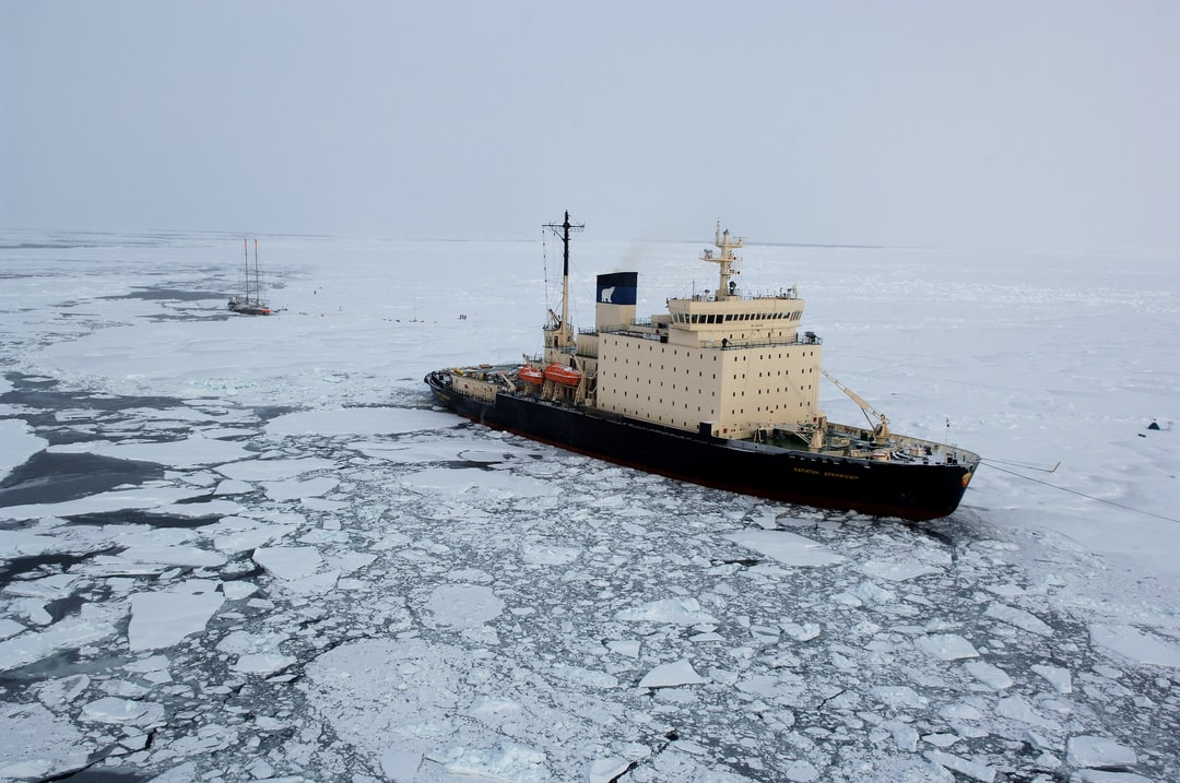 The KAPITAN DRANITSYN moored in the ice near the French sailing vessel TARA which will intentionally be frozen in the ice for two years to study Arctic climatology and oceanography.