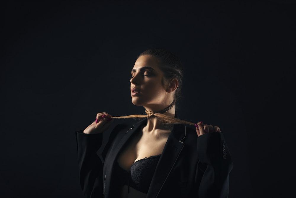 woman wearing black notched-lapel suit jacket