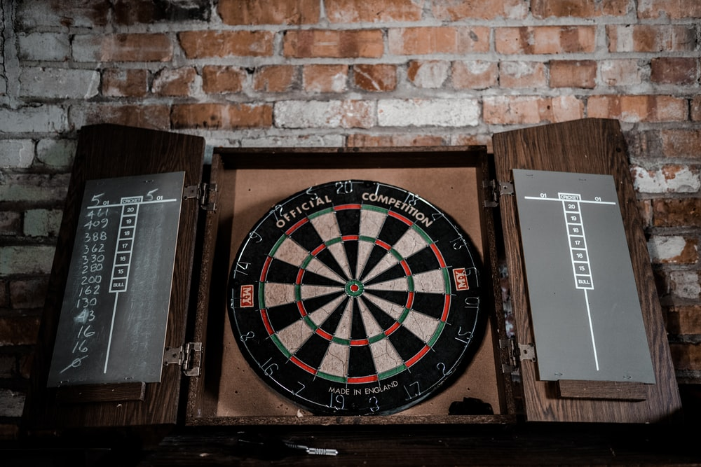black and brown dartboard