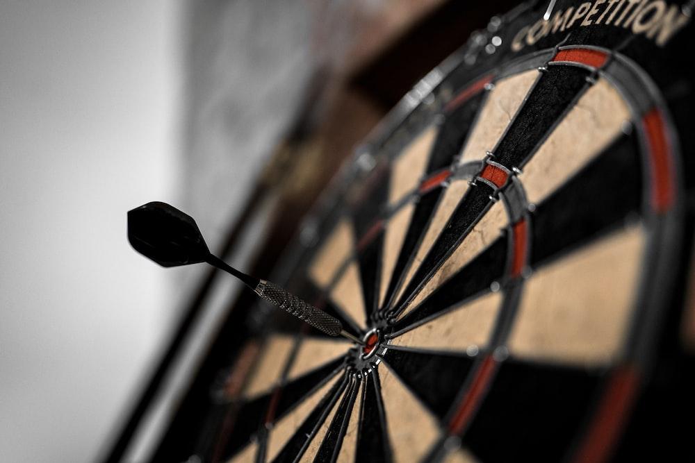 black and brown dart board
