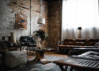 table lamp beside brick wall
