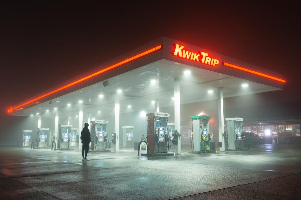 person standing near Kwik Trip gas station