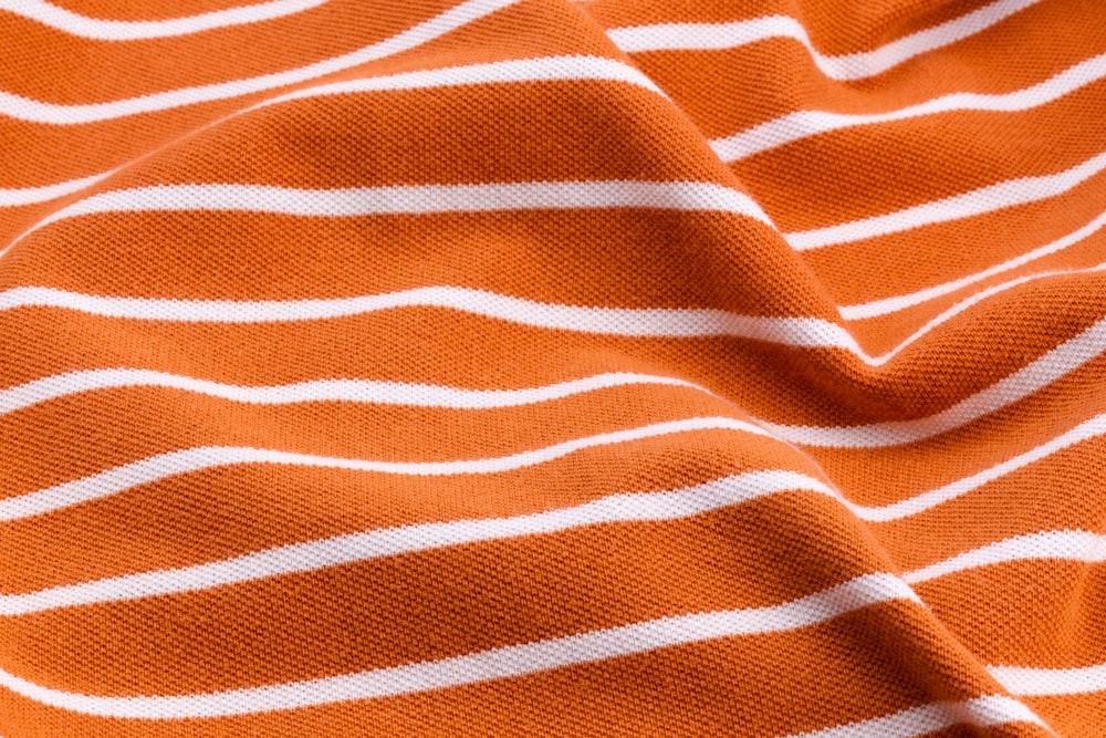 white and orange stripe textile